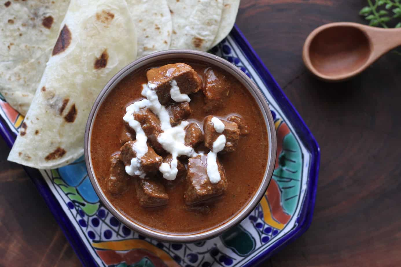 Texas Chile with yogurt drizzle and tortillas