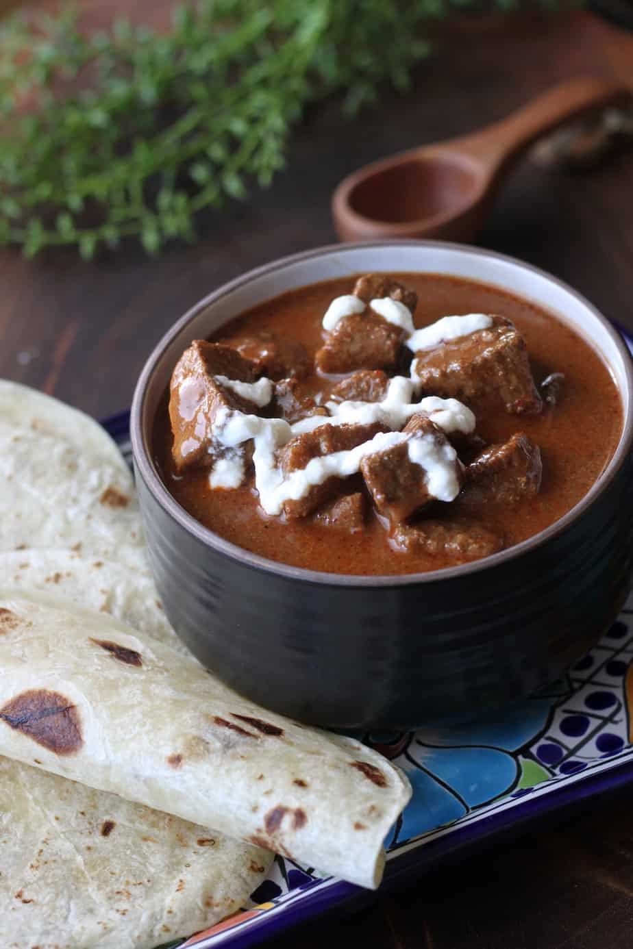 bowl of Texas Chile with yogurt drizzle