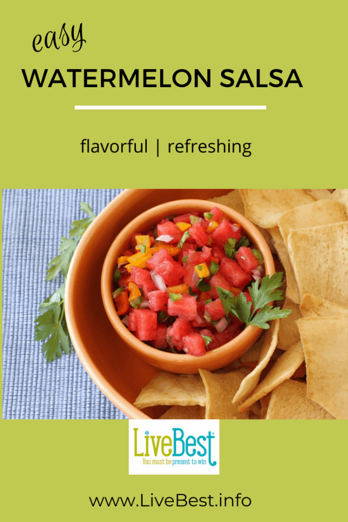 small bowl of watermelon salsa surrounded by pita chip