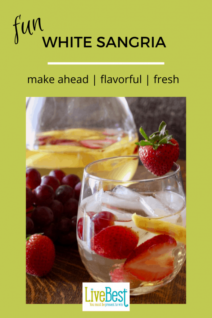 glass of white wine sangrias with strawberries and peaches
