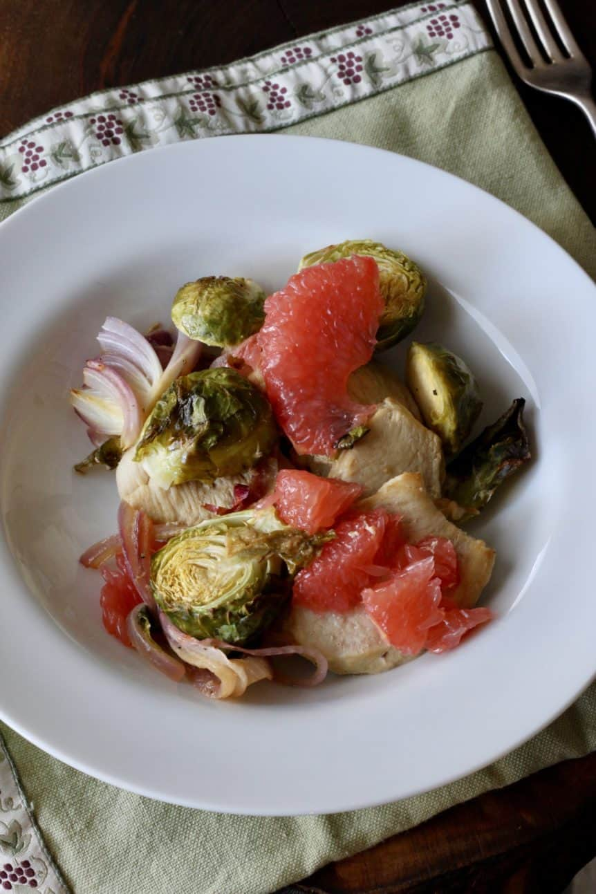 Chicken with Brussels Sprouts and Grapefruit in bowl with fork
