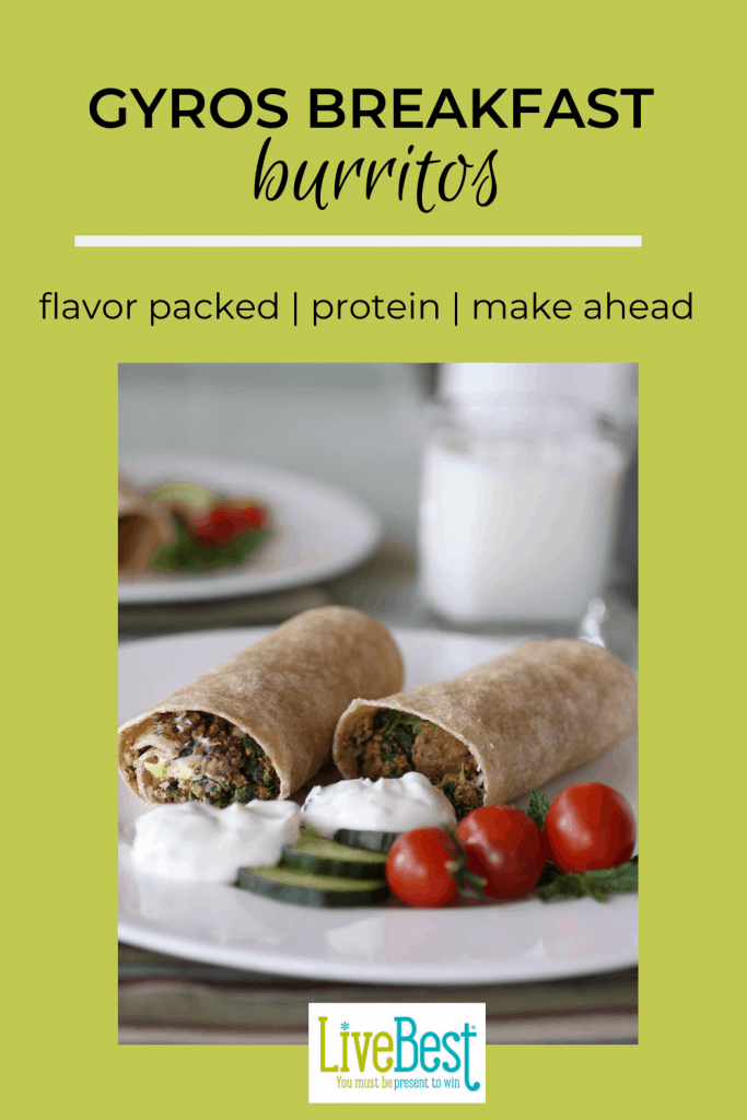 2 gyros breakfast burritos on plats with cucumber and tomatoes