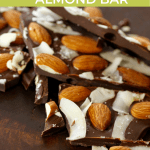 Chocolate bar topped with toasted almonds and coconut shards