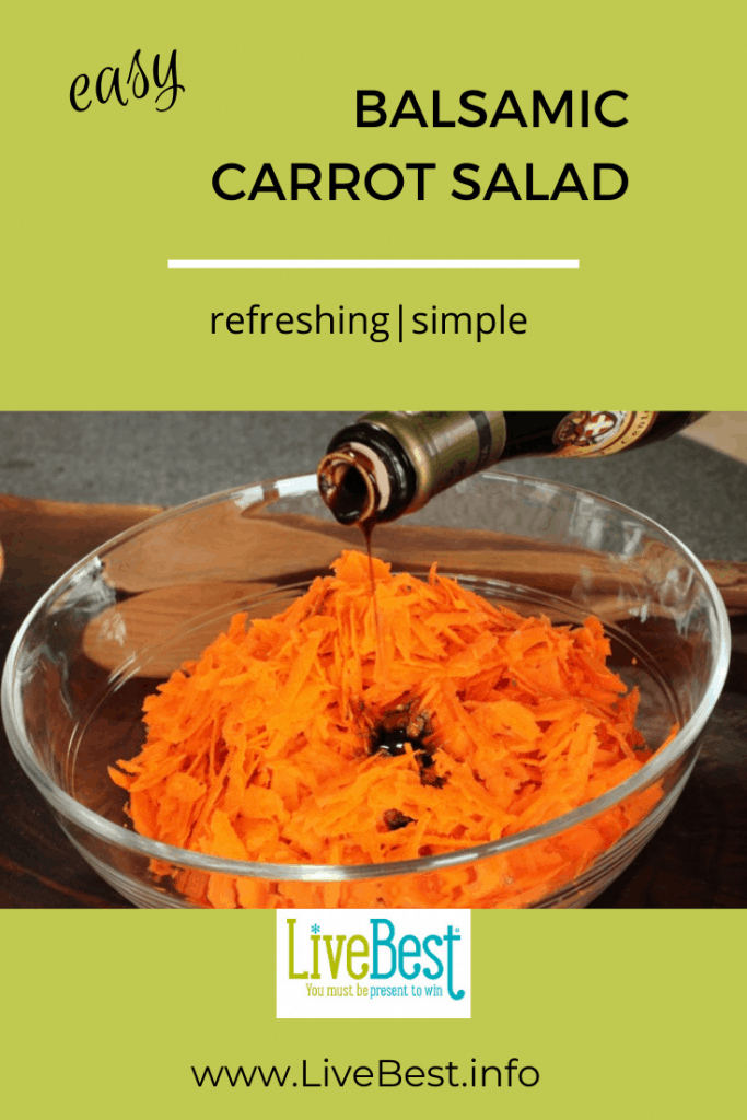 shredded carrots in a bow with balsamic vinegar drizzled over