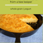 cast iron skillet corn bread with a slice removed