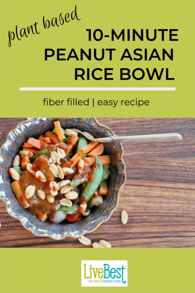 bowl of brown rice, vegetables. spicy peanut sauce and peanuts