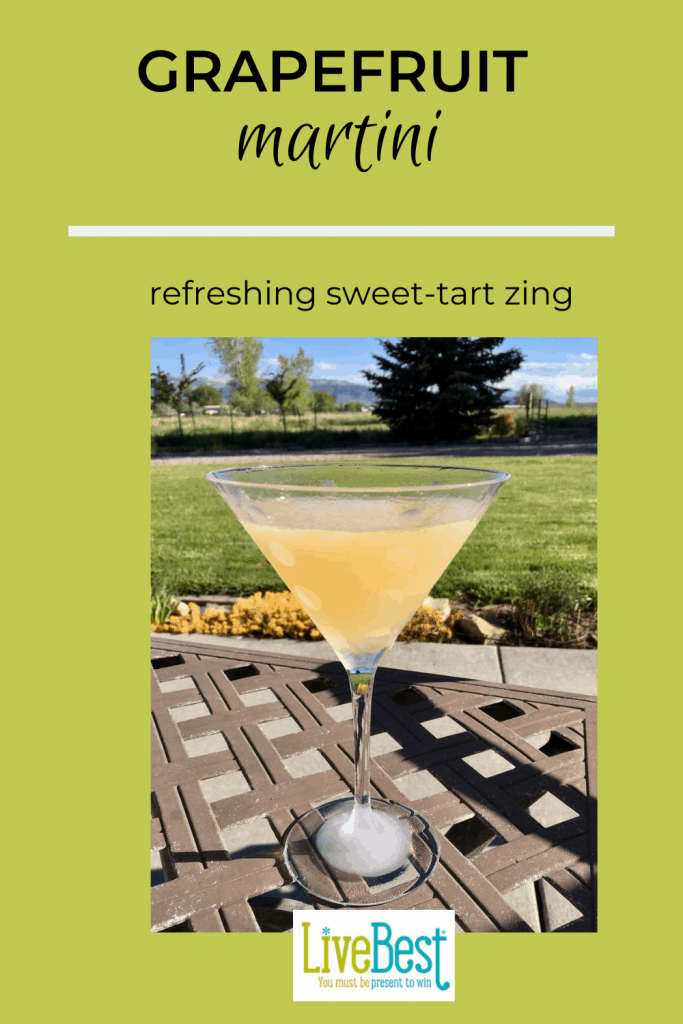 Frosty glass with grapefruit martini on an outside table