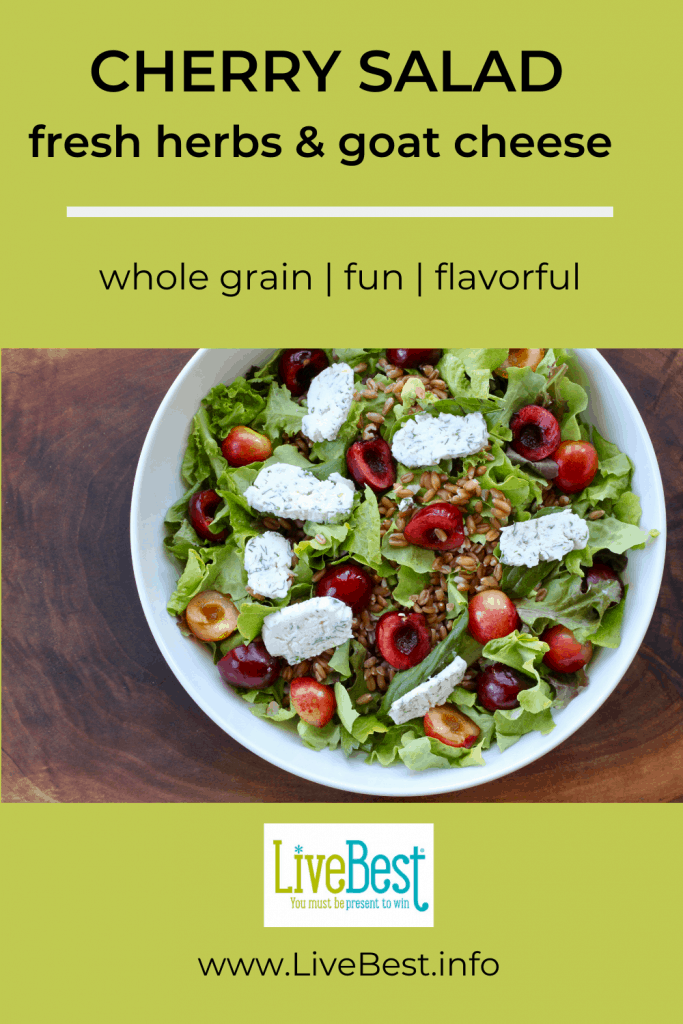 bowl of whole-grains and fresh cherry salad  with fresh herbs and goat cheese discs.