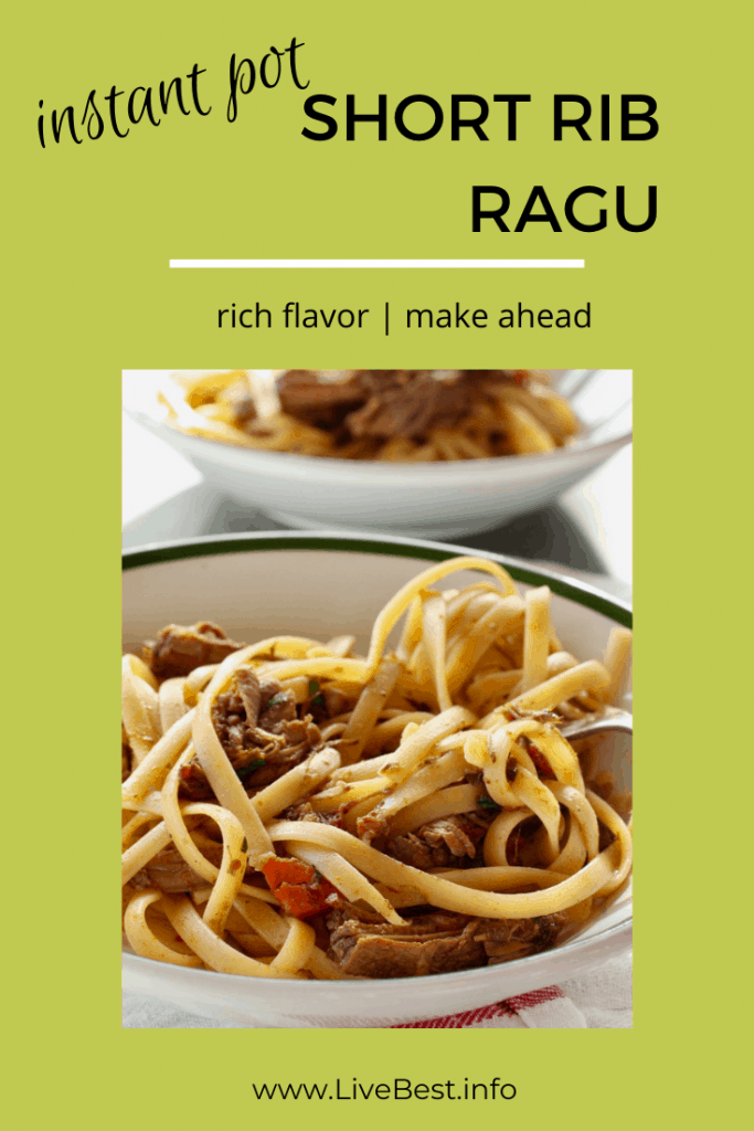 two bowls of pasta with short rib ragu mixed in