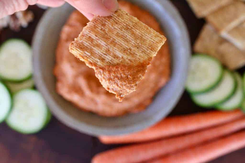 Roasted Red Pepper Dip on a cracker