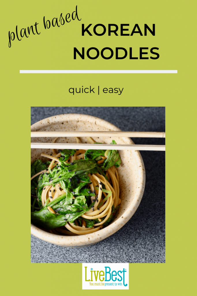 bowl of noodles and spinach with chopsticks