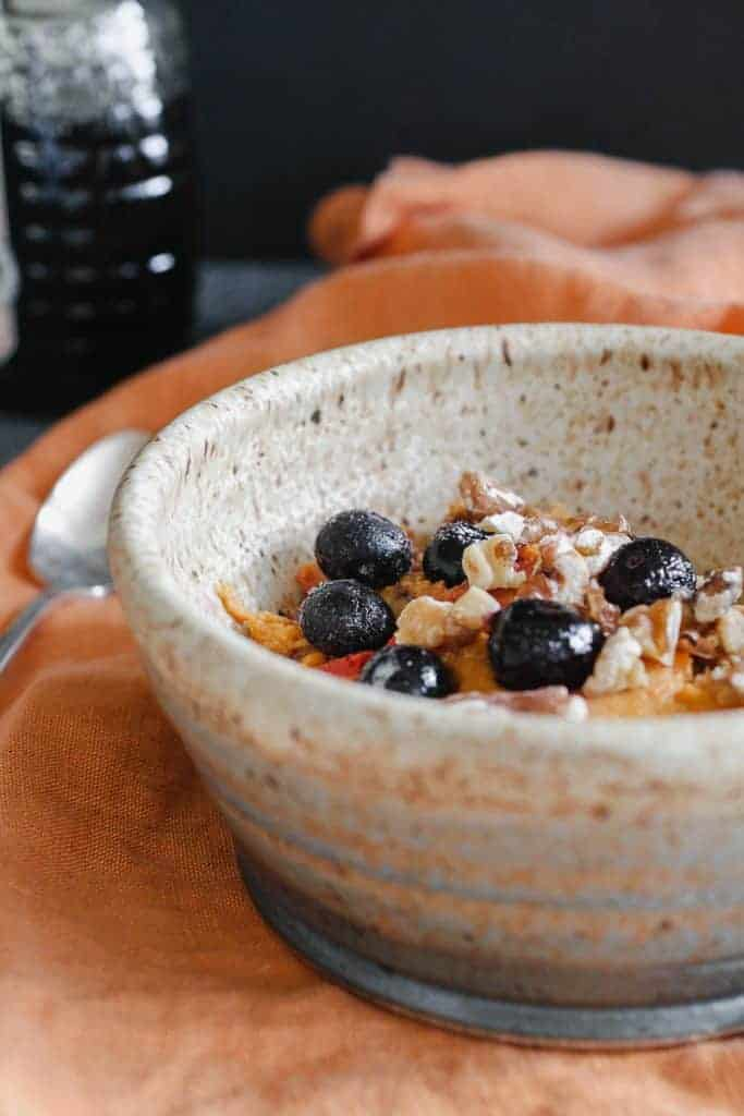 Pumpkin Spice Baked Oatmeal | Oats, pumpkin, walnuts and berries are baked into a hearty low sugar breakfast. Real food deliciously. www.LiveBest.info