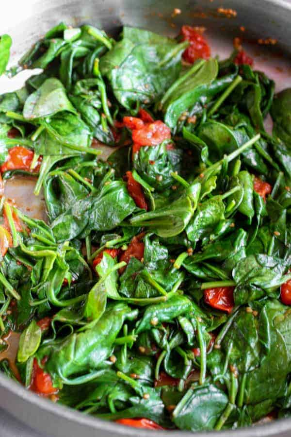 Tomato Spinach Saute   Healthy, easy, vegetarian recipe with fresh cherry tomatoes and spinach, garlic, olive oil, red chile flakes. www.LiveBest.info