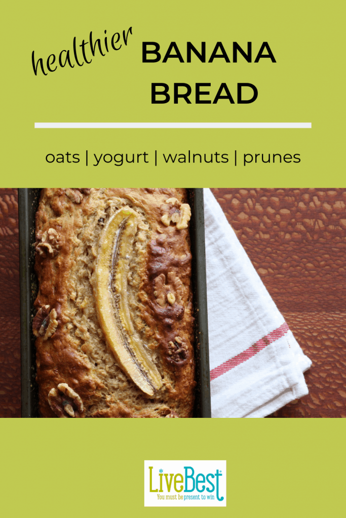 loaf of banana bread with a banana slice baked on top
