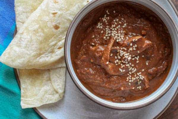 Chicken Mole in bowl with tortilla