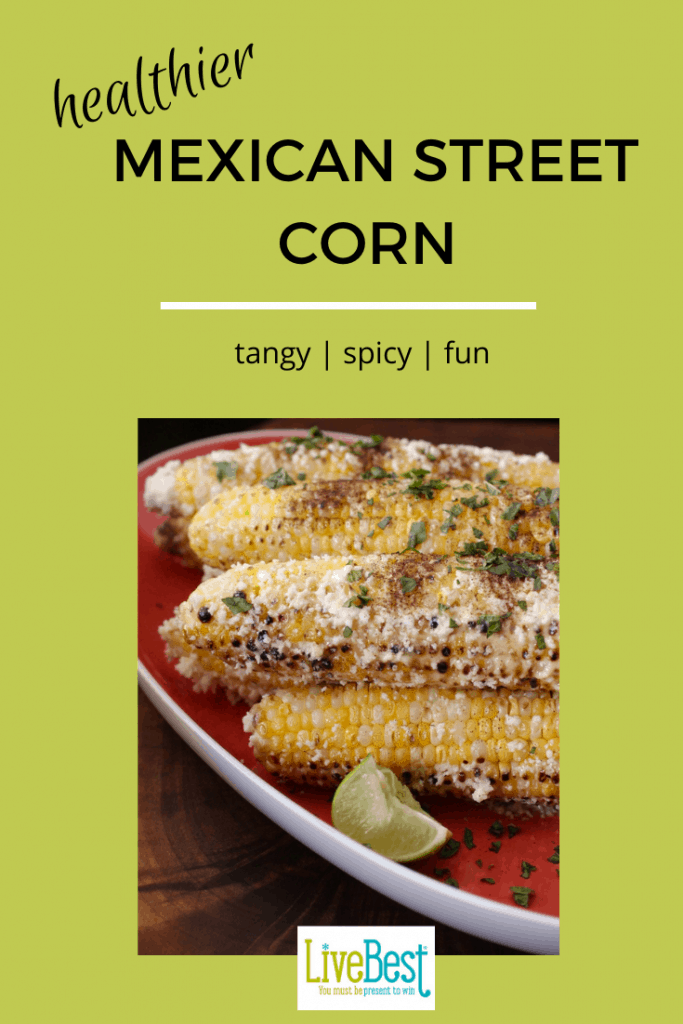 Mexican Street corn with cheese and herbs on a platter