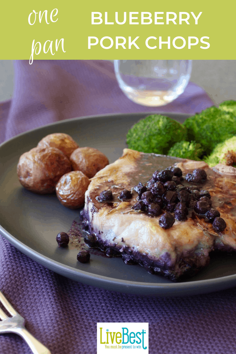 plate with blueberry topped pork chop, broccoli and potatoes