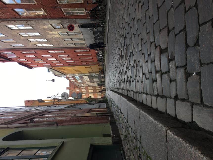 photo of cobble stone street with Copenhagen