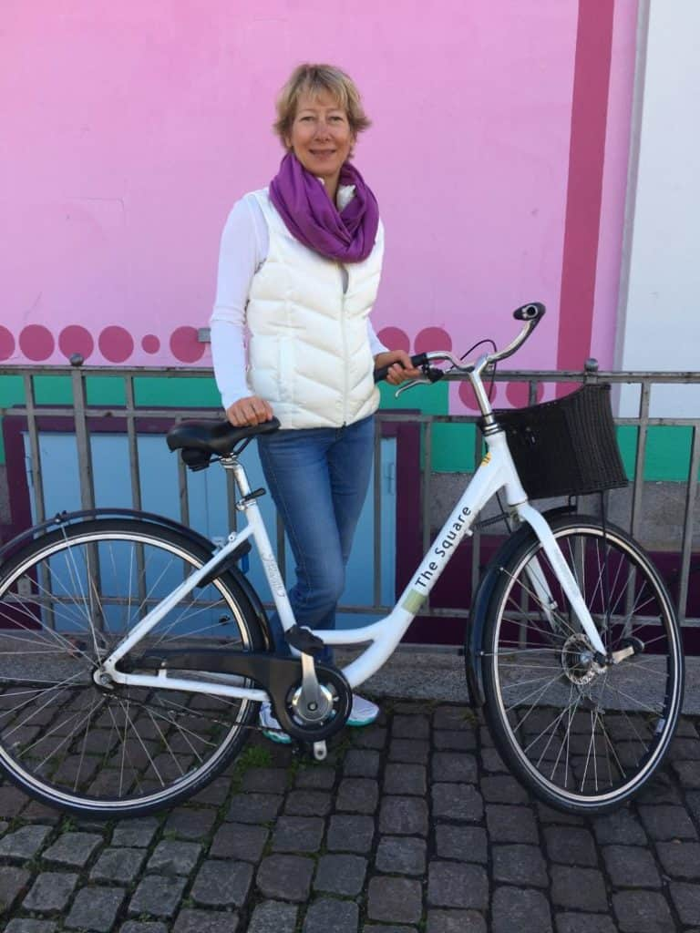 woman with bicycle in Copenhagen