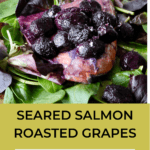 seared salmon with roasted grapes on spinach