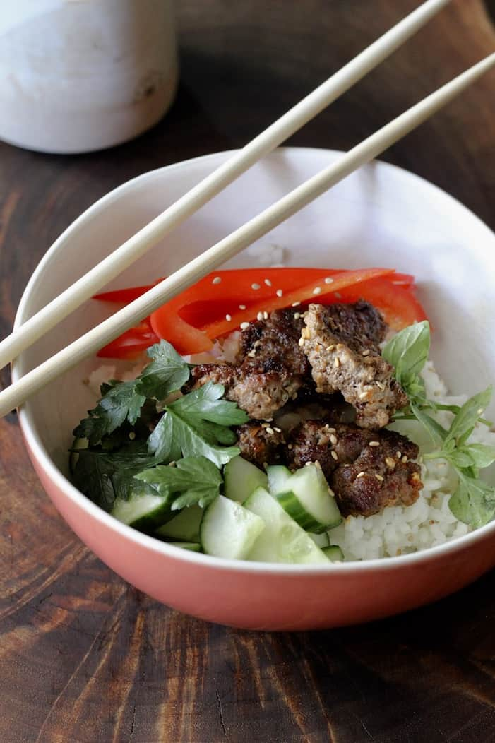 sushi rice bowl with cucumber, red pepper, parsley and min