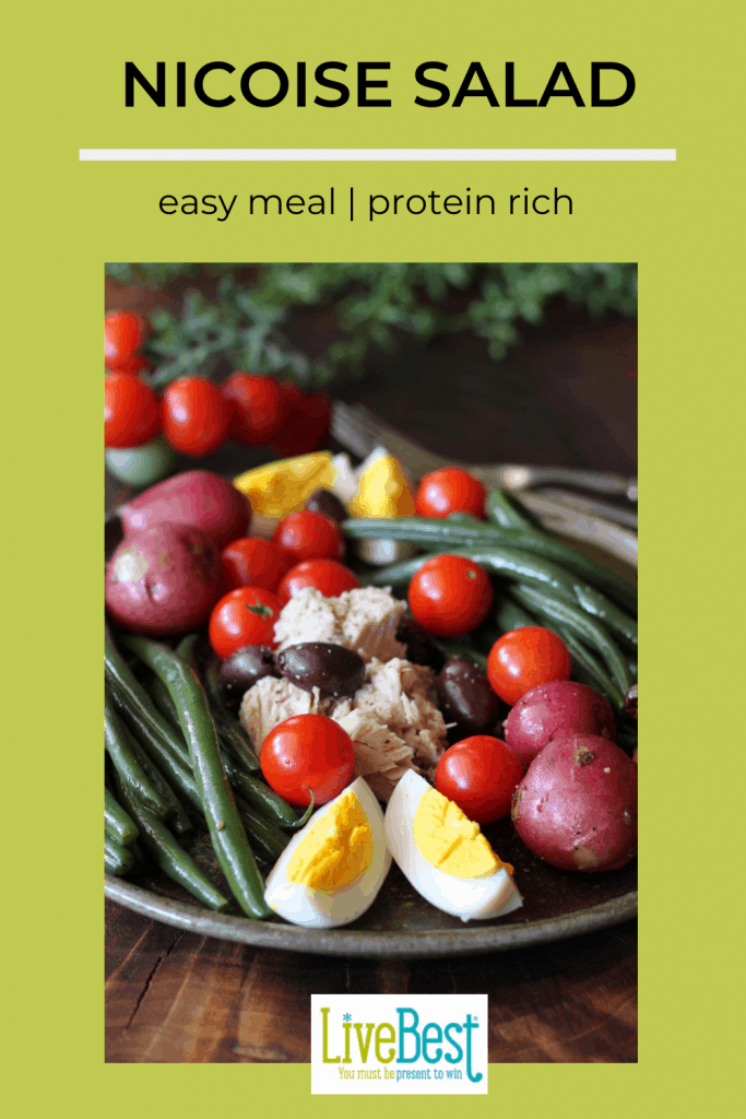 plate of beans, tuna, eggs, potatoes, tomatoes