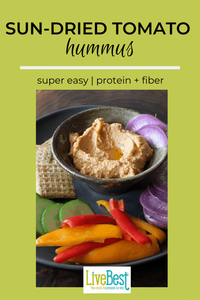 bowl of sun-dried tomato hummus with fresh vegetables