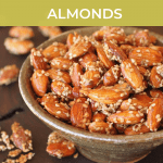 bowl of honey and sesame seed coated almonds