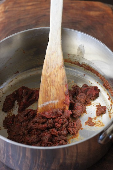 Cooking flour and spices to make enchilada sauce